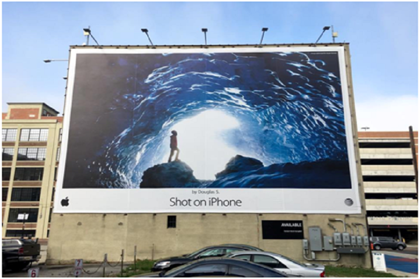Billboard displaying a 'shot on iphone' photo