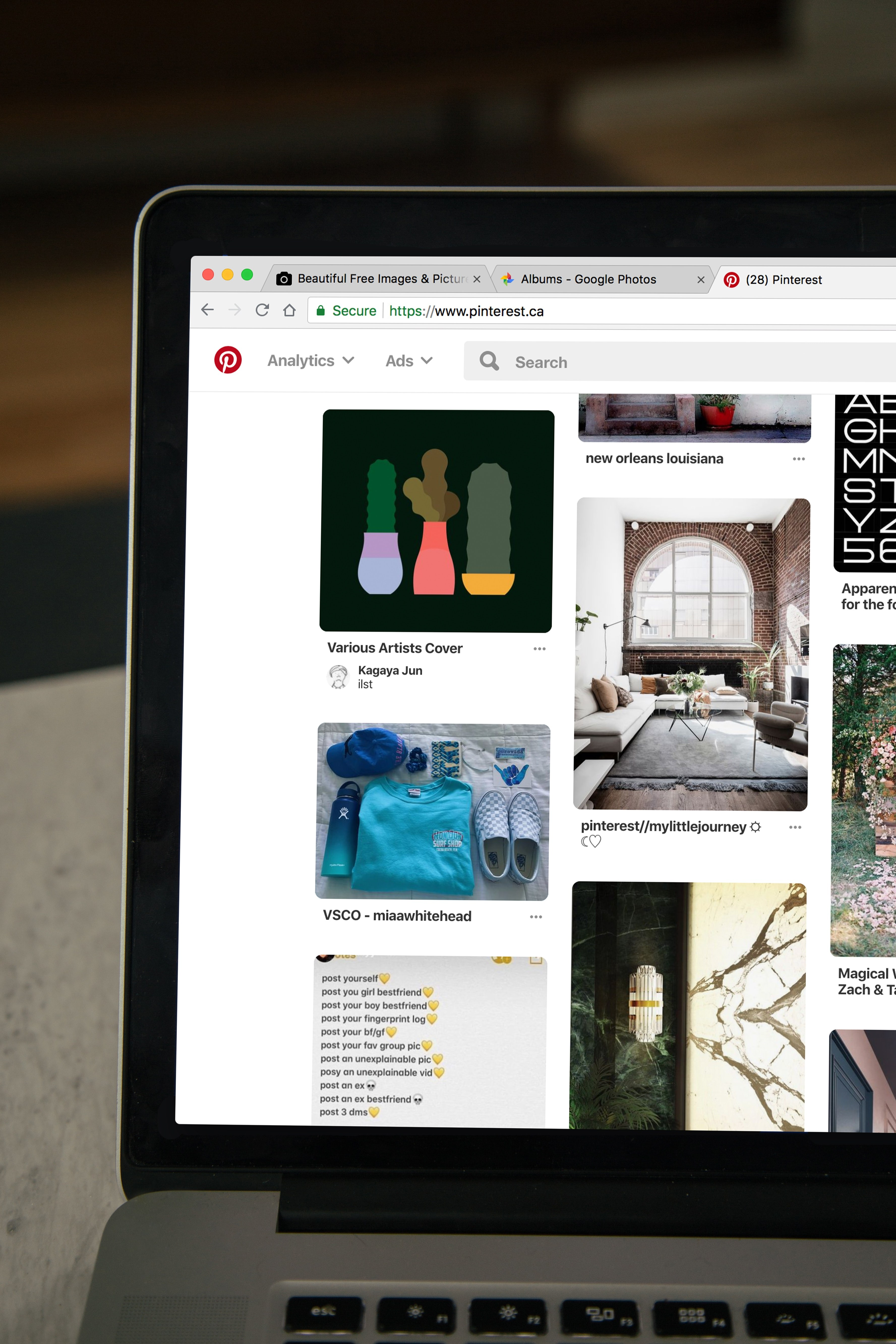 a laptop screen with pinterest homepage loaded