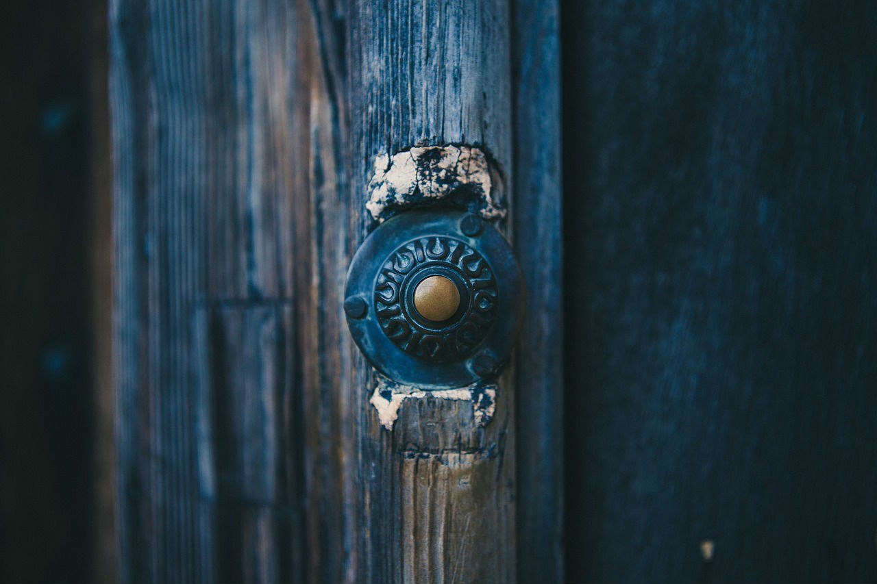 Doorbell on a blue wooden doorway