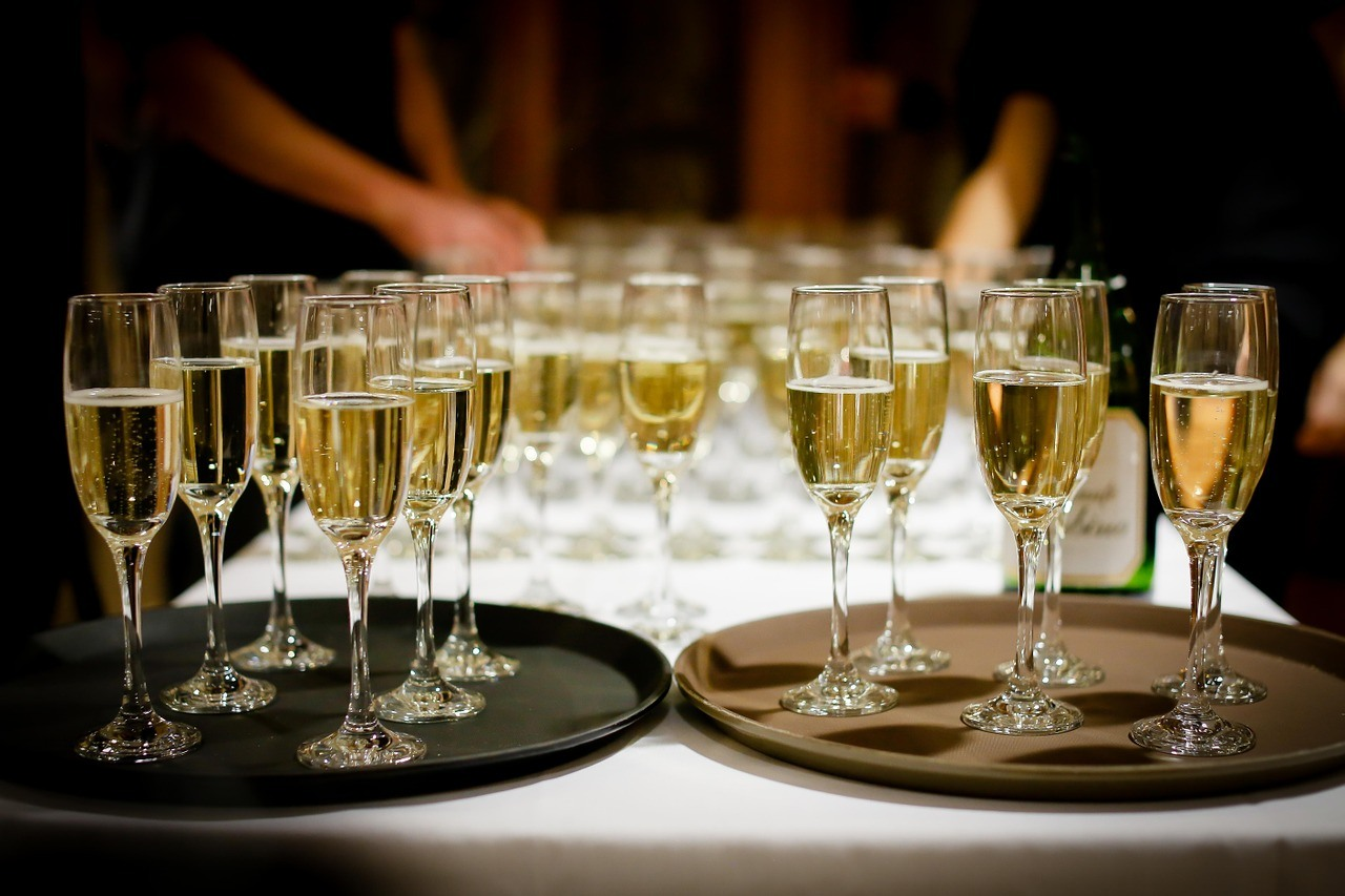 full champagne glasses on trays