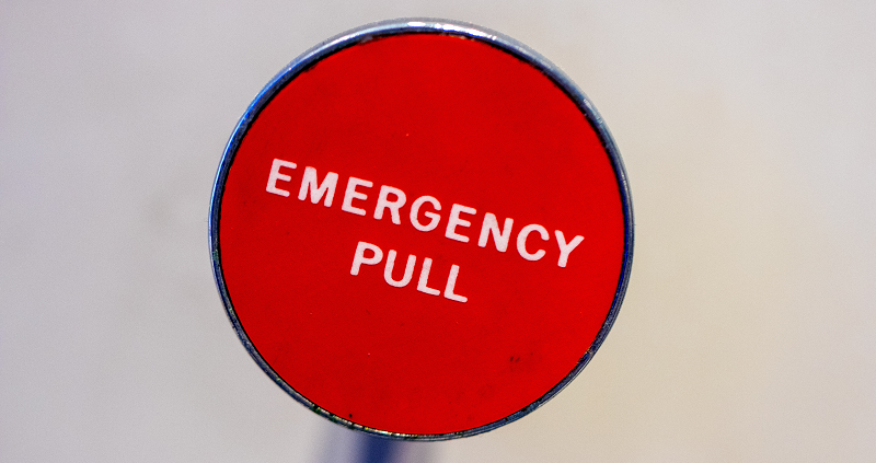 A red circular 'emergency pull' button against a white background