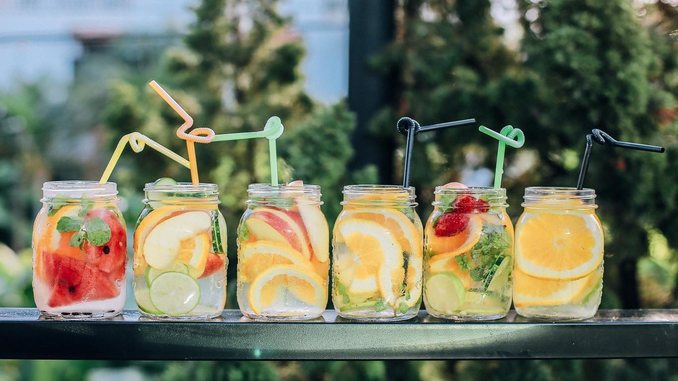 six cocktail mason jars in a row