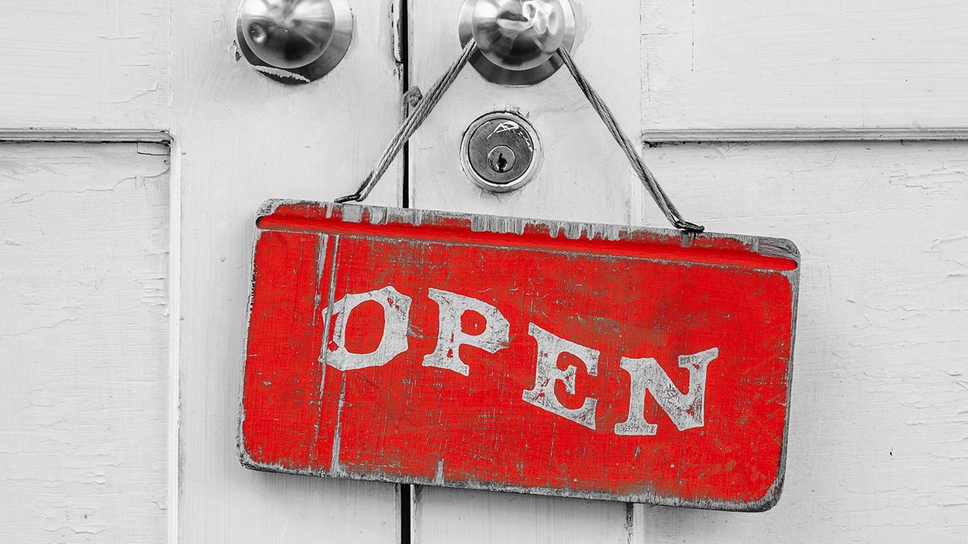 Red open sign hanging from door