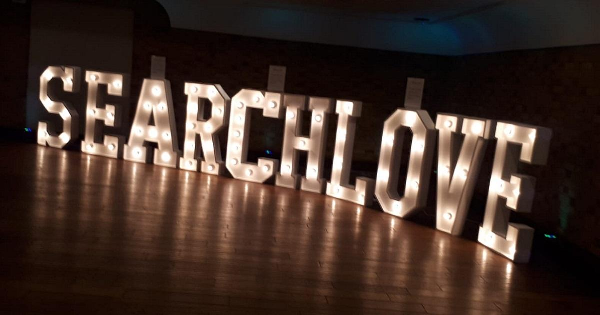 searchlove spelled out in bulb lights