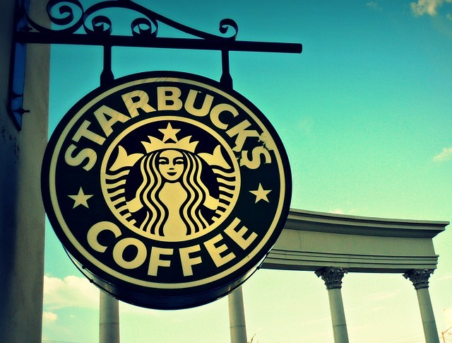 starbucks signage outside against a blue sky