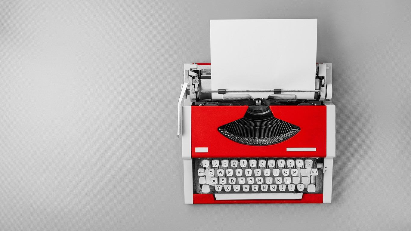 a red typewriter on a white background