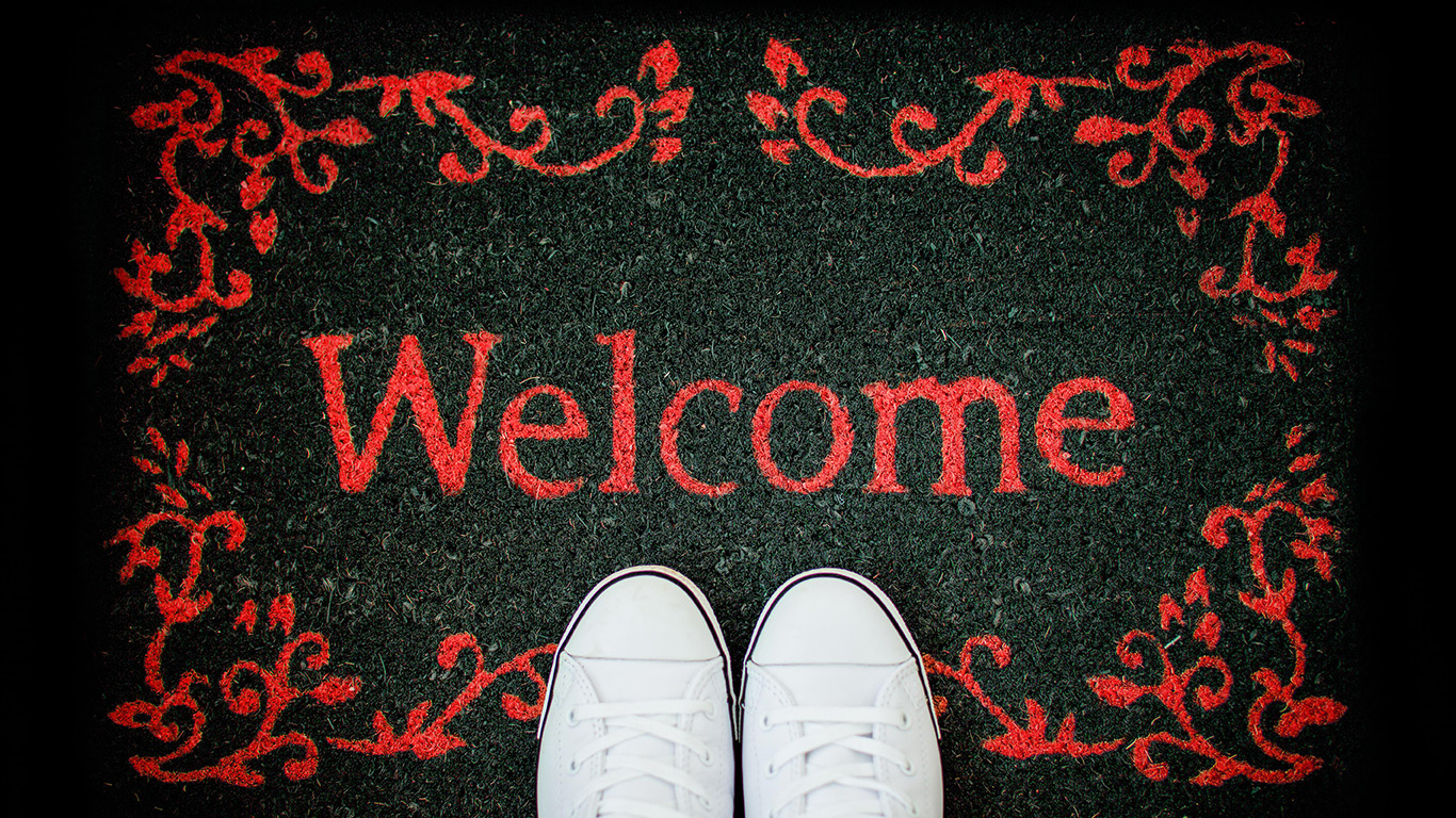 Red trainers on a welcome mat